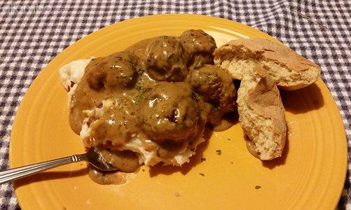 """Swedish"" meatballs, mashed potatoes and gravy."