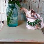 A small table that I painted. I also created the embellishment that is on t...