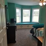 baby girls room with window seat inside