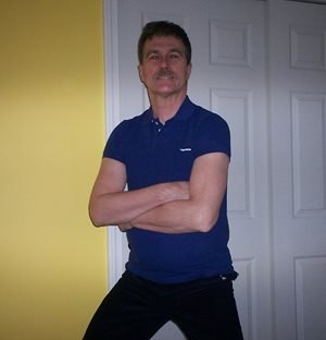 posing at home clad in a blue slim fit dsquared2 polo shirt