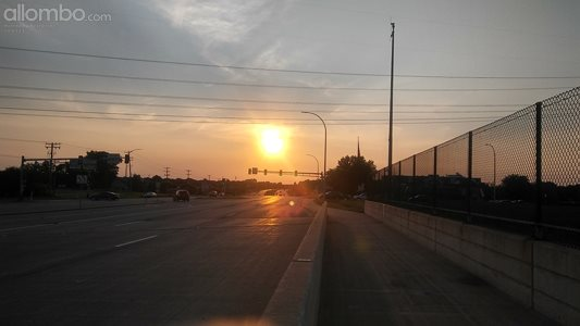 Walking over the highway. Sunset.